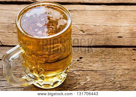 Cold Light Beer Mug On The Wooden Background