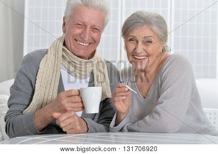 Portrait of a smiling ill senior couple