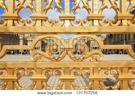 VERSAILLES FRANCE - MAY 12 2013: This is fragment forged gilded railings of the palace of Versailles.