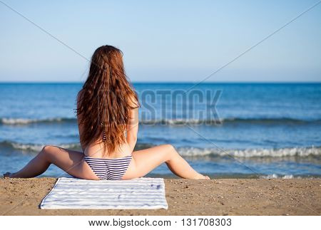 Beautiful Woman On The Beach During Summer Vacation Back View