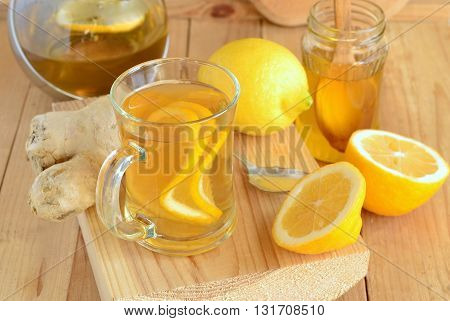 Lemon ginger drink with honey, tea,  selective focus
