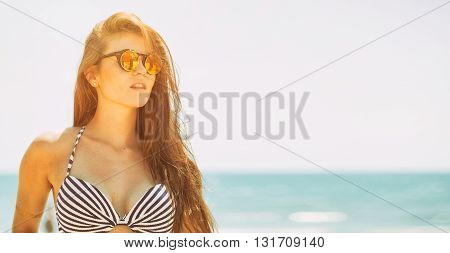 Beautiful Woman On The Beach In Hot Summer Sun During Vacation