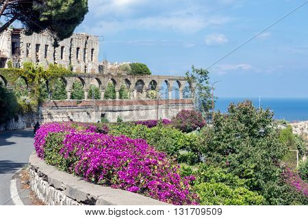 Bougainvillea flowers and ancient architecture in Taormina at the Siclilian Island Italy