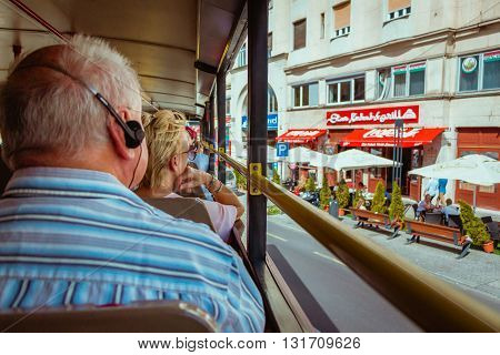 Budapest Hungary - Sep 16 2015: View from back of the top deck on Budapest Sightseeing bus with people looking outside at the city.
