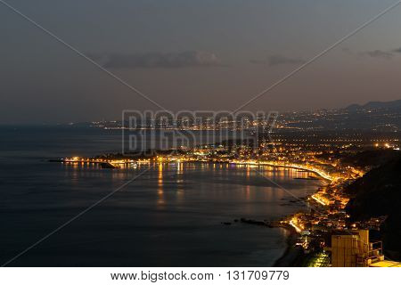 Aerial view in the evening at the Sicilian coast near Taormina at Sicily Italy