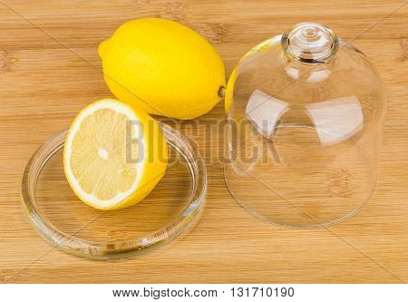 Transparent Saucer With Lid And Lemon On Table