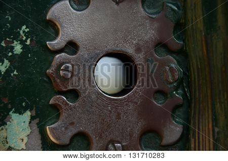 ancient green metallic keyhole in Rome with screw