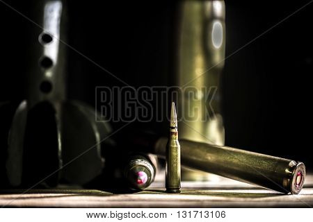 Weapons, Cartridge On Wooden Background