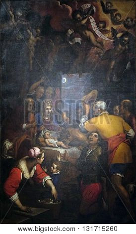 LUCCA, ITALY - JUNE 06, 2015: Altarpiece depicting Adoration of the Shepherds, work by Domenico Cresti in Cathedral of St.Martin in Lucca, Italy, on June 06, 2015