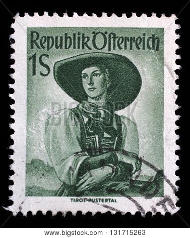 ZAGREB, CROATIA - SEPTEMBER 13: A stamp printed in Austria shows image woman in national Austrian costumes, Tyrol, Puster Valley,series, circa 1951, on September 13, 2014, Zagreb, Croatia