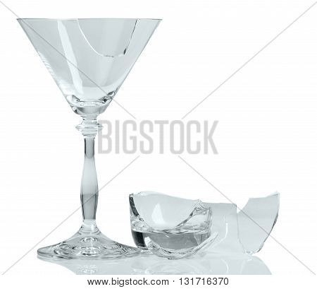 Fragments of broken wine glass close-up isolated on white background.