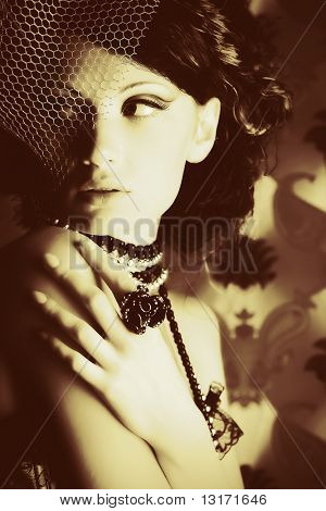 Portrait of a fashionable lady over vintage background.