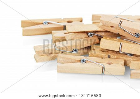 Wooden clothespins close-up isolated on white background.