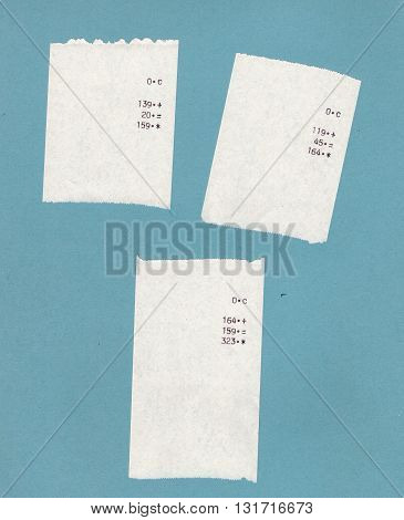 Three bills or receipts isolated over light blue background