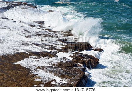 Tesselated rock platform weathered by ocean waves
