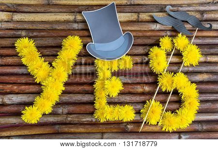 Word made of yellow dandelions flowers on the old wooden background concept design idea