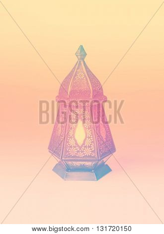 A colorful graphic design with a ramadan lamp. Stock photo of Ramadan background.