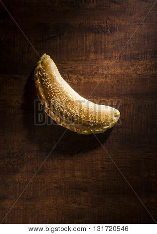 A stuffed middle eastern meat pie or pastry - Fatayer placed on dark wooden background. Ramadan recipes.