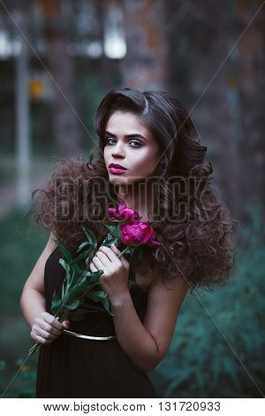 Beautiful Woman With Creative Hairstyle Holding Purple Peonies