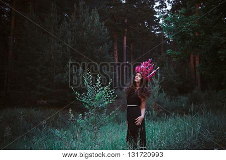 Beautiful Woman In Forest With Crown From Purple Peonies