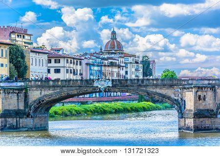 Famous bridge Ponte Vecchio with Florence cityscape in background.