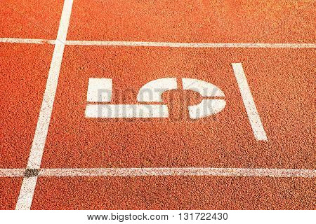 Number Five. Big White Track Number On Red Rubber Racetrack. Gentle Textured Running Racetracks In A