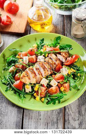 Fresh Salad With Chicken Breast, Arugula And Tomato