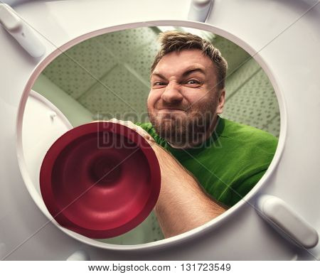 Man with cup plunger