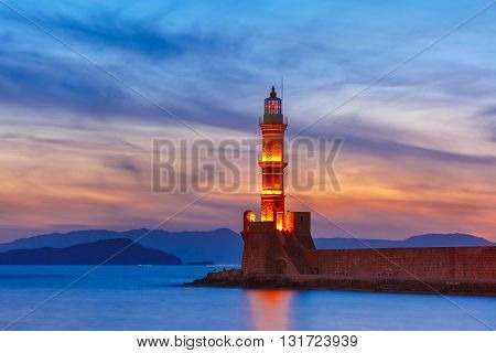 Lighthouse in old harbour of Chania at sunset, Crete, Greece