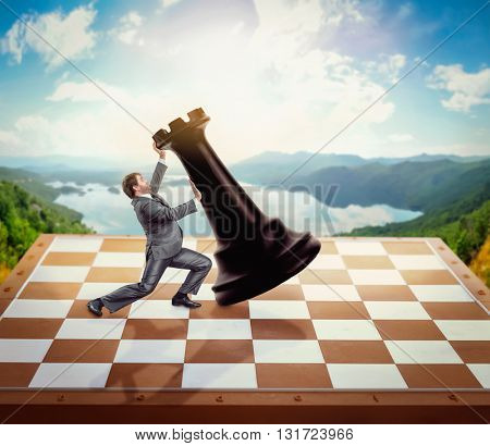 Businessman fighting with a chessman