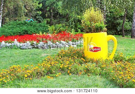 KYIV, UKRAINE - AUGUST 31, 2014: Flower composition with Lipton mug on annual traditional 59 flower exhibition