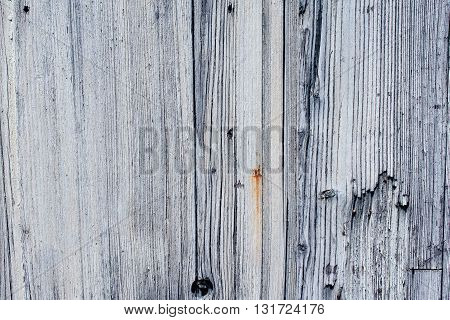 gray and white cracked wooden wall with shadows