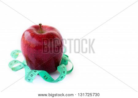 Red apple and measuring tape on a white background