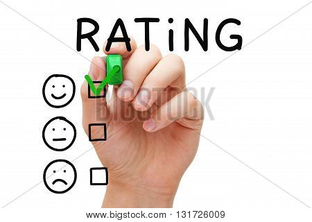 Hand putting check mark with green marker on excellent rating. Customer satisfaction concept.