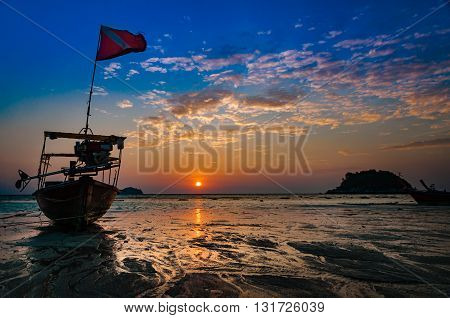 Beach in the morning. Dawn time during sunrise with traditional boat