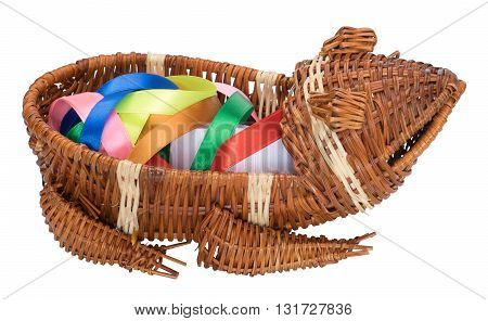 Wicker basket in the form of a frog with color bands inside. Isolated on the white background. Side view.