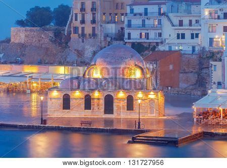Scenic view Venetian embankment in Chania with the Mosque of Hassan Kuchuk Pasha at night.  Crete, Greece.