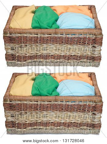 Front view of wicker basket with clothes. Isolated on teh white background. With shadow and without.