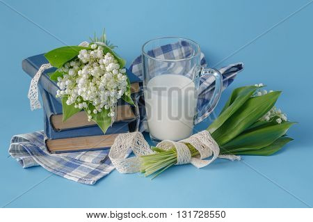 Milk Glass On The Blue With Flowers