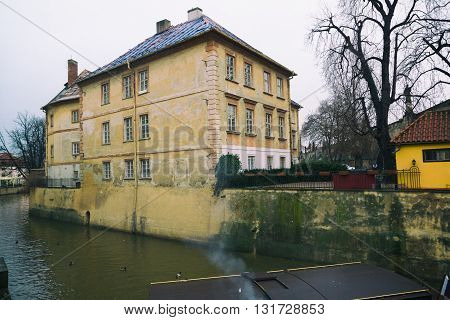 Old apartment house on the Bank of the river Vltava in Prague