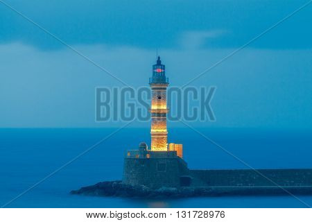 Lighthouse in old harbour of Chania at sunset.  Crete, Greece.