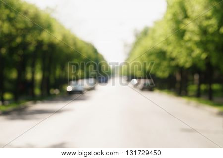 blurred background of town street in sunny summer day, high resolution