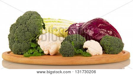 Various types of cabbage: broccoli, cauliflower, Chinese and red isolated on white background.