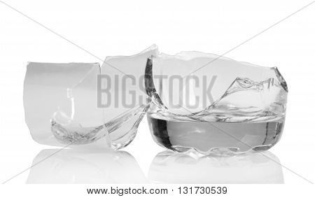 Fragments of broken glass isolated on white background.