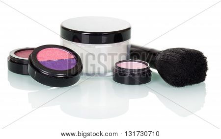 Cosmetic brush, eye shadow, blush and cream isolated on white background.