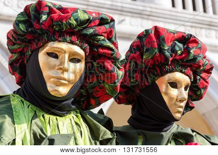 Venice, Italy - February 15, 2015: Two models disguised with the same costume during the Carnival of Venice
