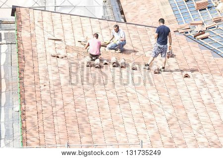 Masons To Work On The Roof For Laying Tiles