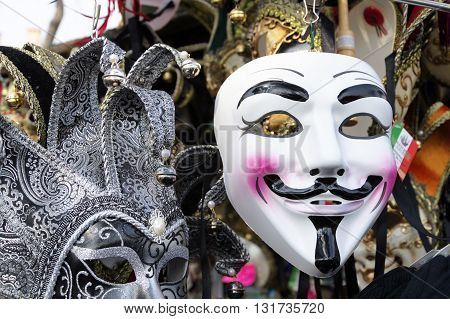Venice, Italy - February 15, 2015: Anonymous masks for sale in a souvenir shop during the Carnival of Venice, in Italy.