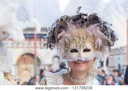 Venice, Italy - February 15, 2015: Beautiful mature woman smiling during the carnival in Venice.