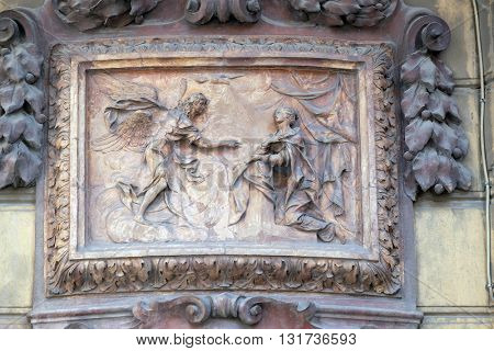 BOLOGNA, ITALY - JUNE 04: Relief of Annunciation scene on the house facade in Bologna, Italy, on June 04, 2015